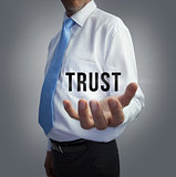Businessman holding the word trust