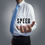 Businessman holding the word speed
