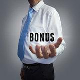 Businessman holding the word bonus