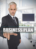 Businessman touching the term business plan