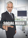 Businessman touching the term social media