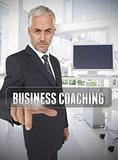 Businessman touching the term business coaching