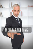 Businessman touching the term web marketing