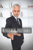 Businessman selecting the term management procedures