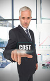 Businessman selecting the word cost