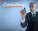 Businessman writing the word consulting
