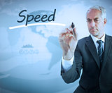 Businessman writing the word speed