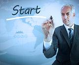 Businessman writing the word start