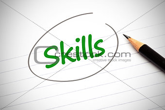 Skills word written in green on a notepad