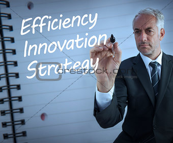 Businessman writing efficiency, innovation and strategy