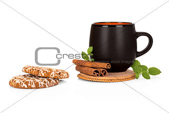 Black tea cup with cinnamon and cookies on white background