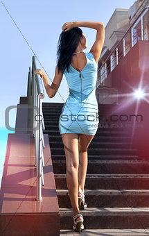 brunette goes on steps
