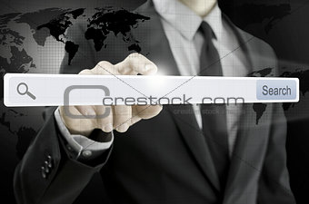 Business man pointing at search bar on virtual screen