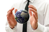 "Male hands holding the  earth globe. ""Elements of this image fur"