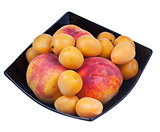 peaches and apricots in black plate