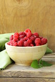 fresh organic ripe berry raspberry on a wooden table