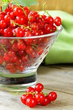 Organic ripe red currant on a wooden table
