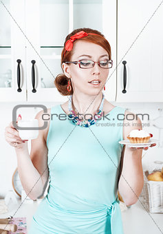 Beautiful woman with cake and coffee