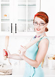 Beautiful housewife with utensils