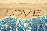 LOVE inscription on the sand beach