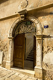Ancient door on the street in Porec, Croatia