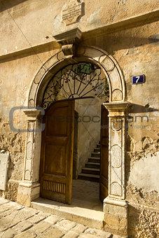 Ancient door on the street in Porec, Croatia