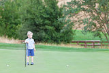 kid at the golf course