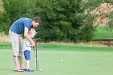 family of two at the golf course
