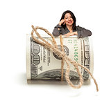 Hispanic Woman Leaning on a Roll Of Hundred Dollar Bills