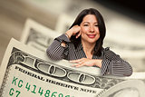 Hispanic Woman Leaning on a One Hundred Dollar Bill