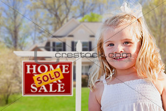Cute Girl in Yard with Sold For Sale Real Estate Sign and House