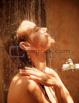 Cute woman take shower