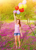 Happy woman with colorful balloons