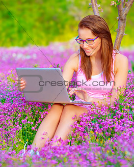 Cute woman with laptop outdoors