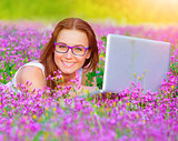 Cute girl with laptop outdoor