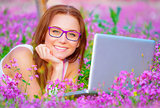 Happy female with laptop outside