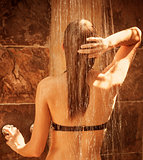 Cute female taking shower