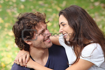 Couple cuddling and flirting in a park