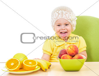 little girl with healthy food sitting at table isolated on white