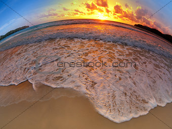 wide angle shot of beach on sunset