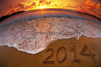 new year 2014 digits on ocean beach sunset