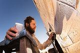Artist Creating Mural