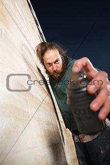 Man Holding Spray Can Close
