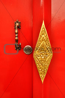 Closed up red handle door in temple