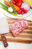 chopping fresh pork ribs and vegetables