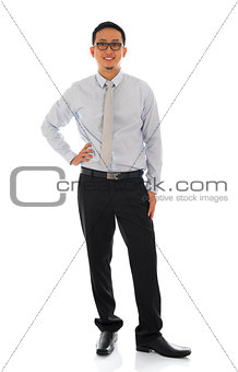 Asian businessman standing isolated