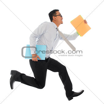 Asian businessman in hurry running