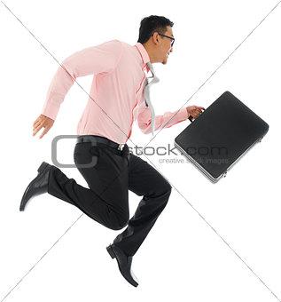 Asian businessman running or jumping