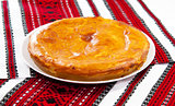 Onion and cheese pie on traditional ukrainian towel