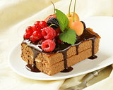 chocolate cake with berries (raspberry, currant, cherry) and chocolate sauce